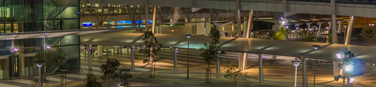 The outer pedestrian foyer area of Adelaide International Airport at night