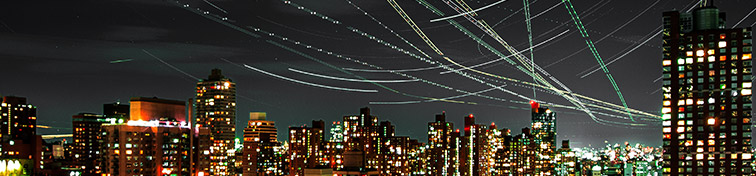 Air traffic overhead from/headed to LaGuardia Airport.