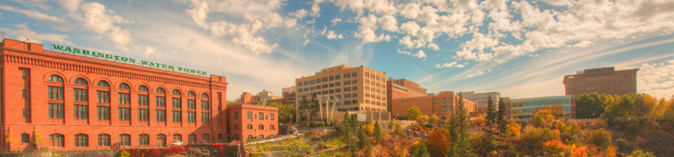 Panoramic cityscape view of Washington Water Power building and the Monroe Street Bridge along the Spokane river, in Spokane, Washington