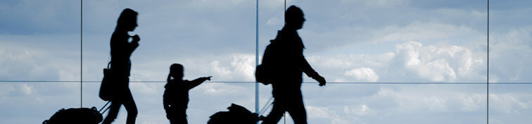 Family walking in an airport