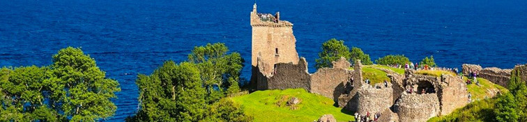 Urquhart Castle along Loch Ness lake in Scotland